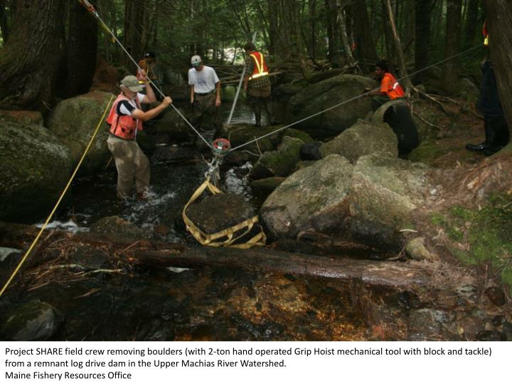 Project SHARE field crew removing boulders (with 2-ton hand operated Grip Hoist mechanical tool with...