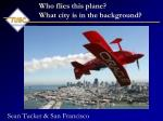 who flies this plane what city is in the background