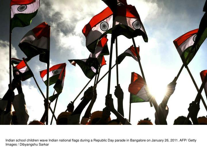 Indian school children wave Indian national flags during a Republic Day parade in Bangalore on January 26, 2011. AFP/ Getty Images / Dibyangshu Sarkar
