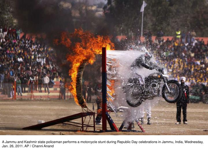 A Jammu and Kashmir state policeman performs a motorcycle stunt during Republic Day celebrations in Jammu, India, Wednesday, Jan. 26, 2011. AP / Channi Anand