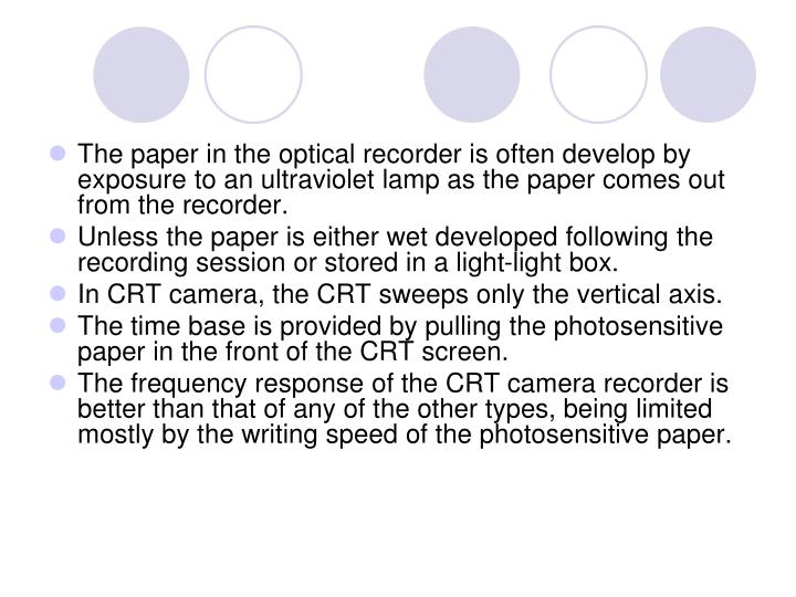 The paper in the optical recorder is often develop by exposure to an ultraviolet lamp as the paper comes out from the recorder.