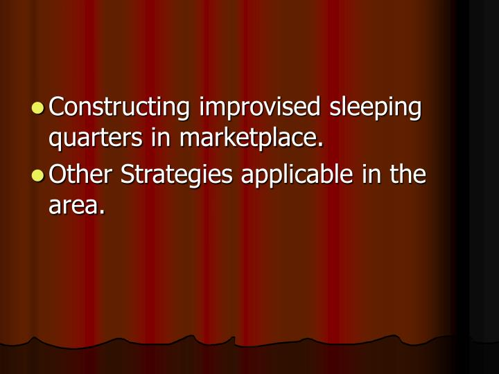 Constructing improvised sleeping quarters in marketplace.