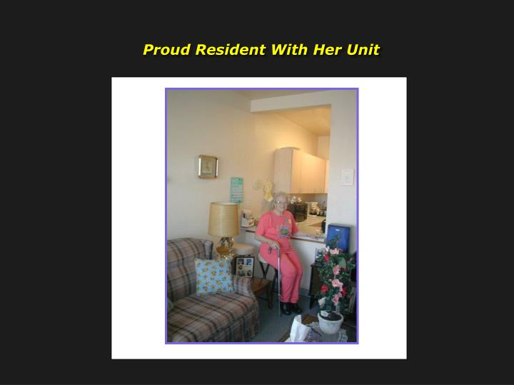 Proud Resident With Her Unit