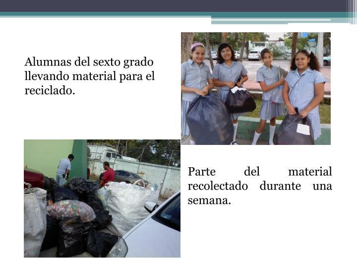 Alumnas del sexto grado llevando material para el reciclado.
