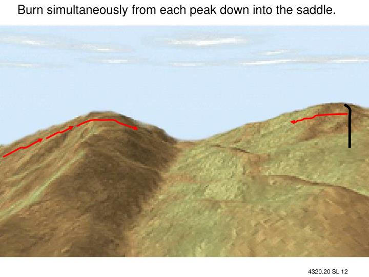 Burn simultaneously from each peak down into the saddle.