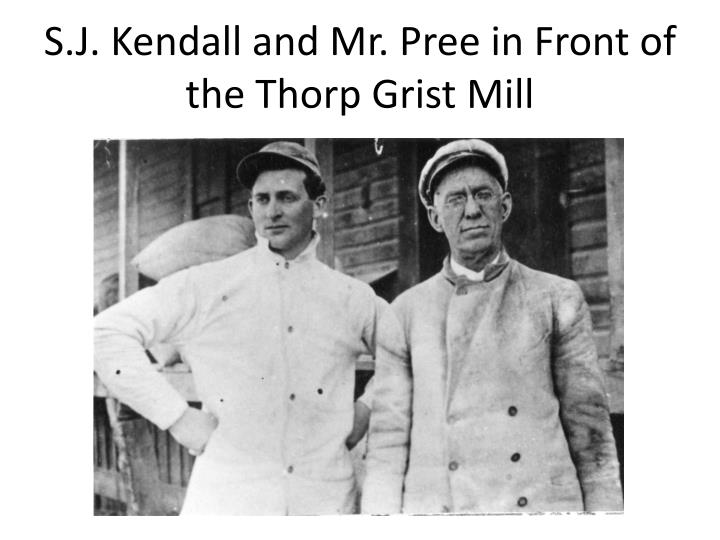 S.J. Kendall and Mr. Pree in Front of the Thorp Grist Mill
