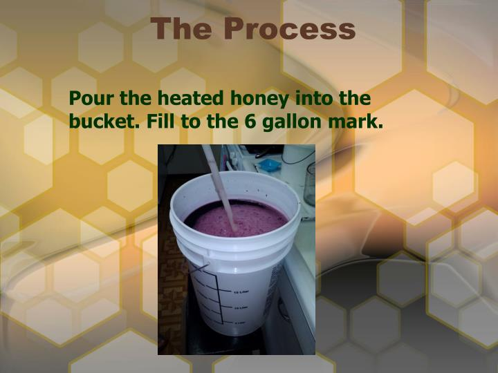 Pour the heated honey into the bucket. Fill to the 6 gallon mark.