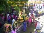 people offering their prayers near their cavadee