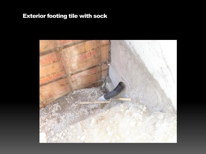 Exterior footing tile with sock
