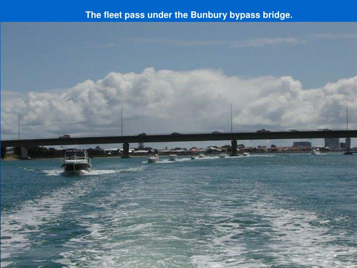 The fleet pass under the Bunbury bypass bridge.