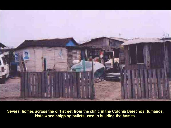 Several homes across the dirt street from the clinic in the Colonia Derechos Humanos.  Note wood shipping pallets used in building the homes.