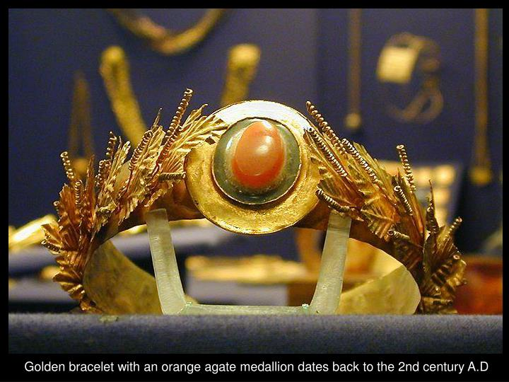 Golden bracelet with an orange agate medallion dates back to the 2nd century A.D