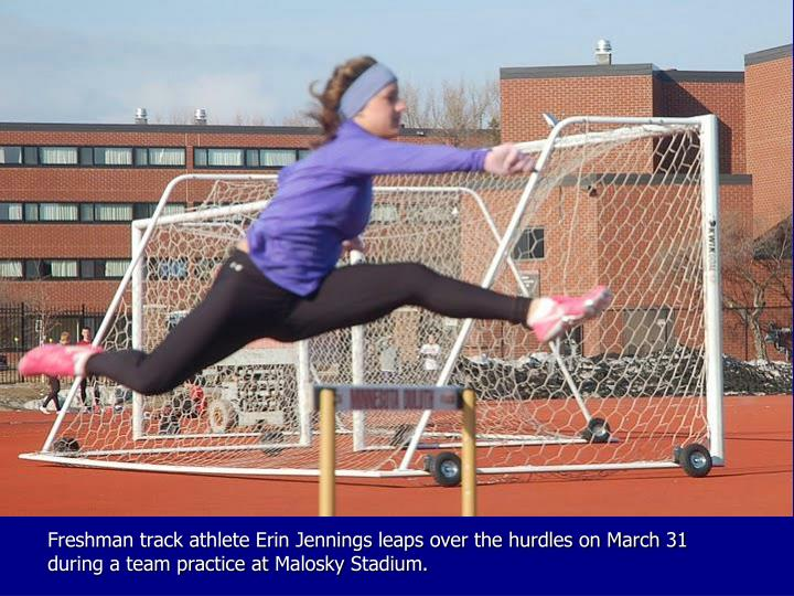 Freshman track athlete Erin Jennings leaps over the hurdles on March 31 during a team practice at