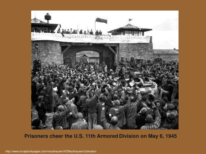 Prisoners cheer the U.S. 11th Armored