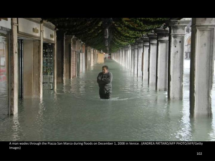 A man wades through the Piazza San Marco during floods on December 1, 2008 in Venice . (ANDREA PATTARO/AFP PHOTO/AFP/Getty Images)