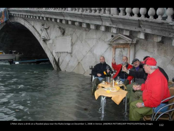 17Men share a drink on a flooded plaza near the Rialto bridge on December 1, 2008 in Venice. (ANDREA PATTARO/AFP PHOTO/AFP/Getty Images
