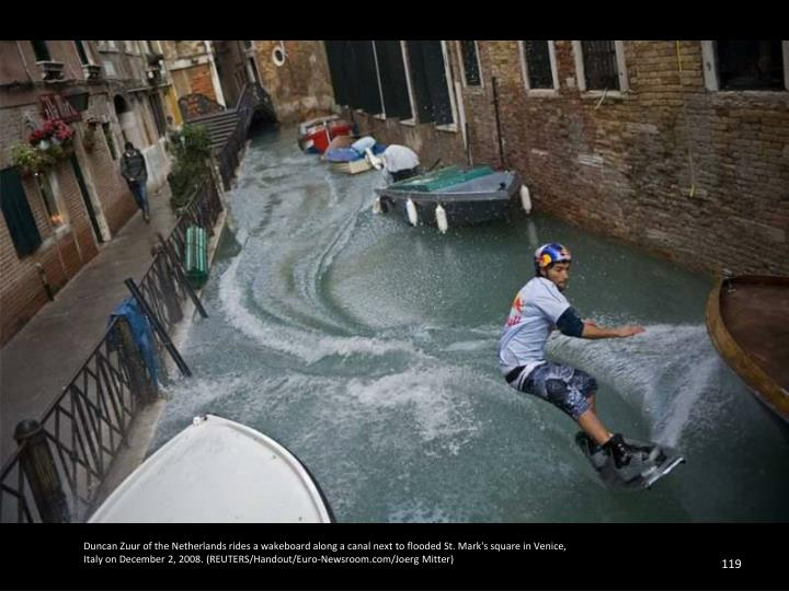 Duncan Zuur of the Netherlands rides a wakeboard along a canal next to flooded St. Mark's square in Venice,