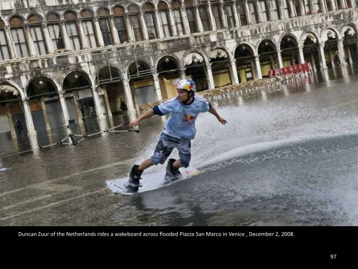 Duncan Zuur of the Netherlands rides a wakeboard across flooded Piazza San Marco in Venice , December 2, 2008.