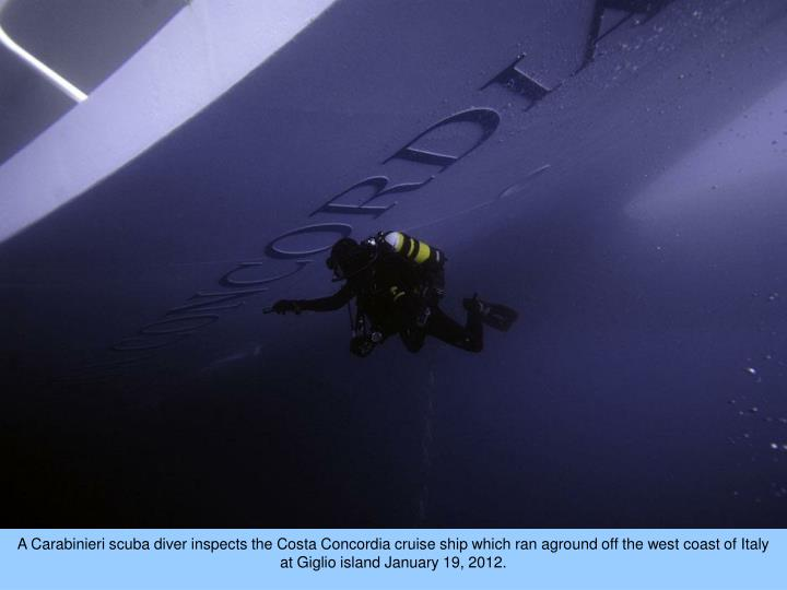 A Carabinieri scuba diver inspects the Costa Concordia cruise ship which ran aground off the west coast of Italy