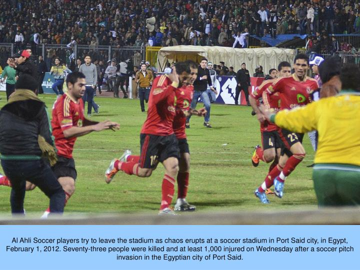 Al Ahli Soccer players try to leave the stadium as chaos erupts at a soccer stadium in Port Said city, in Egypt, February 1, 2012. Seventy-three people were killed and at least 1,000 injured on Wednesday after a soccer pitch invasion in the Egyptian city of Port Said.