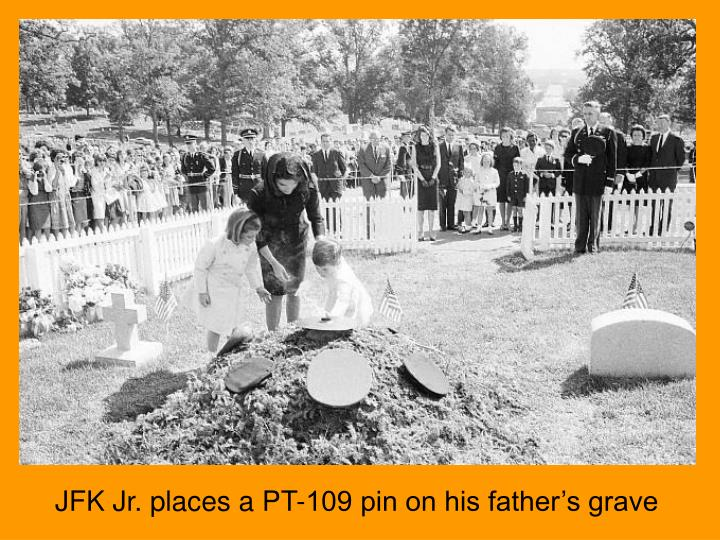 JFK Jr. places a PT-109 pin on his father's grave