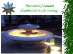 decorative fountain illuminated in the evening