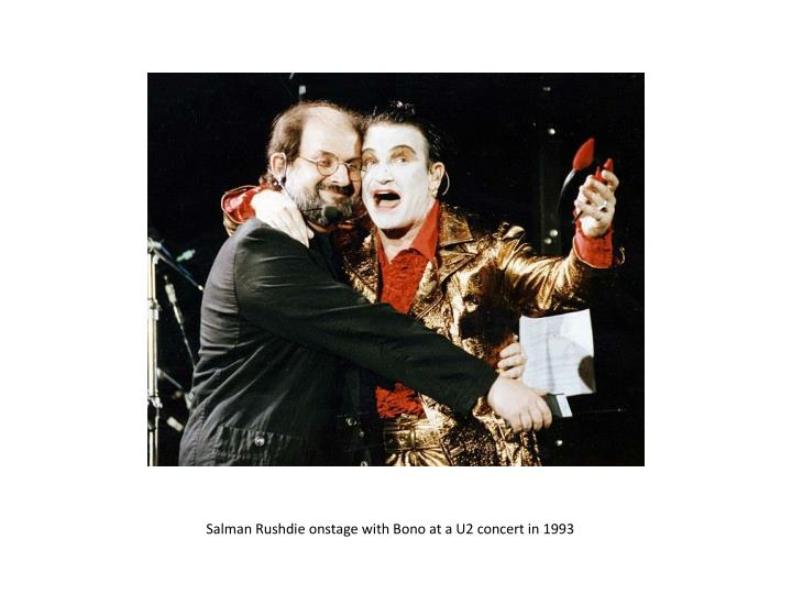 Salman Rushdie onstage with Bono at a U2 concert in 1993