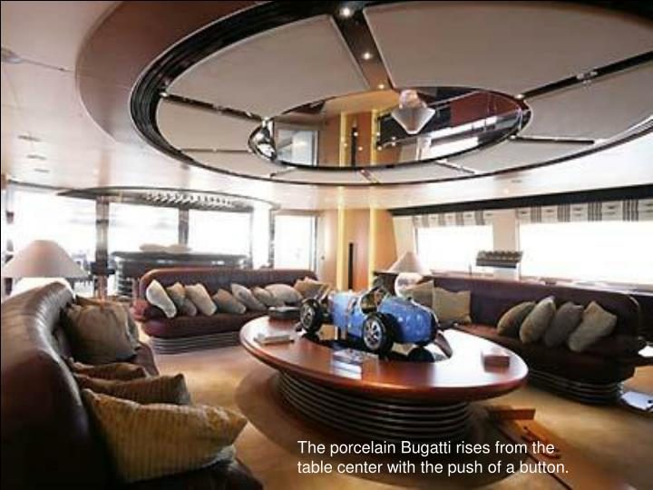 The porcelain Bugatti rises from the table center with the push of a button.